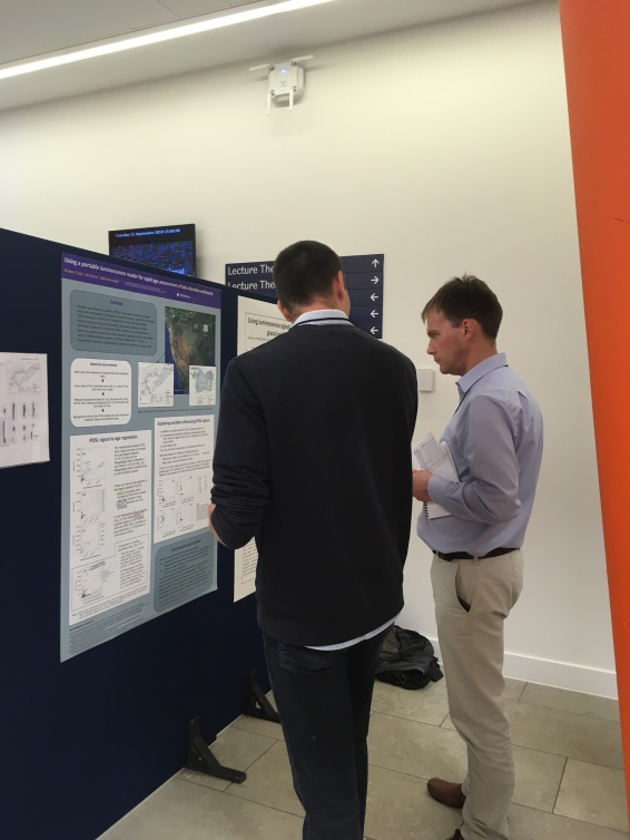 Discussing his initial research findings with other experts in the field